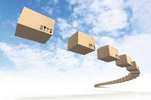 Stream of flying cardboard boxes above blue sky. Fast accuracy delivery metaphor Bild: evannovostro/AdobeStock